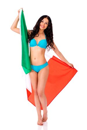 bandera de portugal: Young beautiful brunette woman in blue bikini holding a large flag of Italy, isolated on white background Foto de archivo