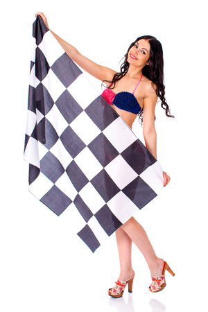 bandera de portugal: Young beautiful brunette woman in bikini holding a large checkered flag, isolated on white background Foto de archivo