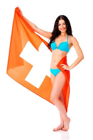 bandera de portugal: Young beautiful brunette woman in blue bikini holding a large flag of Switzerland, isolated on white background