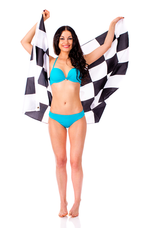 bandera de portugal: Young beautiful brunette woman in blue bikini holding a large checkered flag, isolated on white background