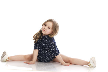 Beautiful blonde little girl, isolated on white background Imagens