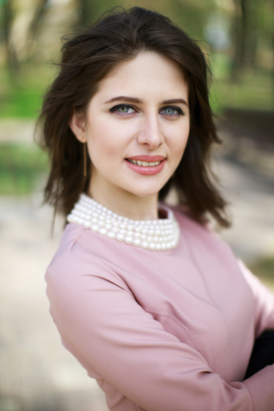 Portrait of a young beautiful Armenian girl in a pink dress Stock Photo