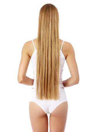 長い美しい女性のブロンドの髪の背面ビュー、孤立した om 白の背景