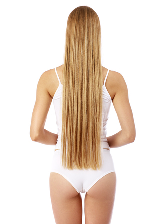 Back view of long beautiful female blonde hair, isolated om white background