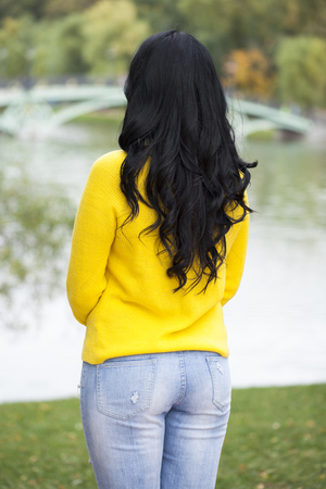 Rear view, Hair beauty brunette model, autumn park outdoors