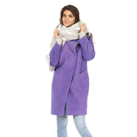 Beautiful young brunette woman in purple autumn coat, isolated on white background