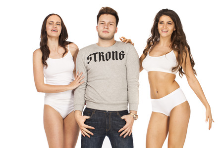 One guy and two sexy girls, isolated on white background