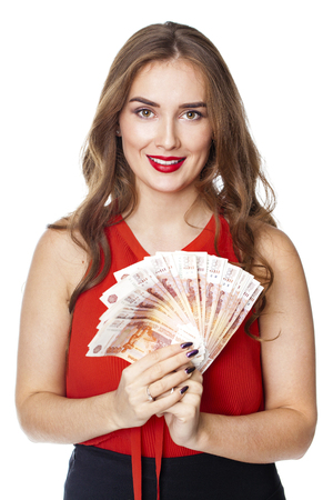 Russian rubles. Young happy woman holding a fan of money, isolated over white background 写真素材