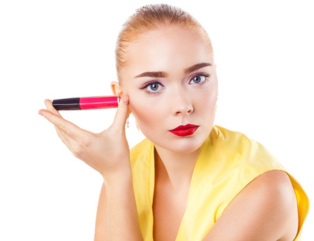 Close Up portrait of young blond woman with red lipstick isolated on white background