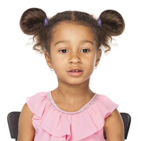 Close up portrait of little african girl with afro hairstyle isolated on white background