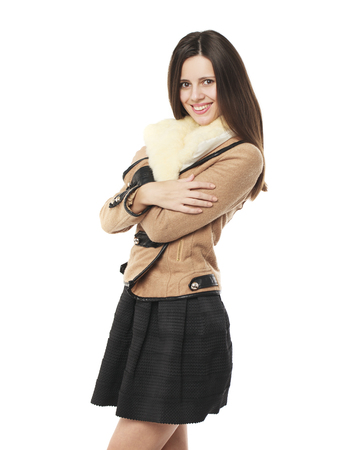visone: Young beautiful brunette woman in stylish in beige sheepskin coat, isolated on white background Archivio Fotografico