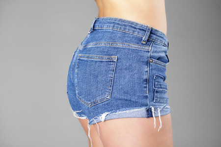Body part sexy blue shorts, isolated on gray background Stock Photo