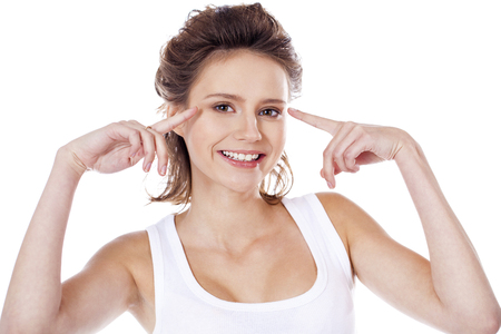 Happy brunette girl in white t-shirt, isolated on white background