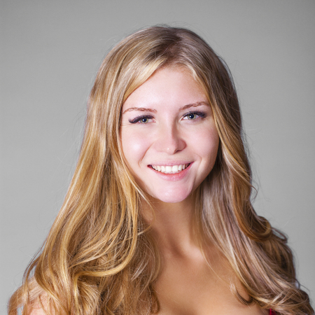Portrait close up of young beautiful happy blonde woman, indoor Stock Photo