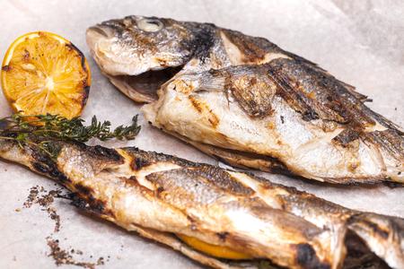 Restaurant dish grilled fish Dorado and Seabass Stock Photo