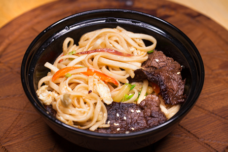 Asian cuisine, restaurant dish noodles with bits of beef