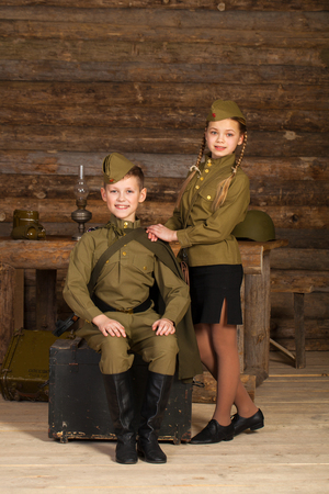 Two children in military uniforms of the Great Patriotic War. World War II Stock Photo