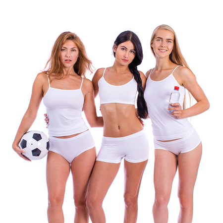 Fitness women. Three young beautiful girlfriends in white sportswear isolated on white background