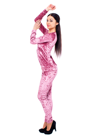 Sexy young woman in velours sport suit on white isolated background