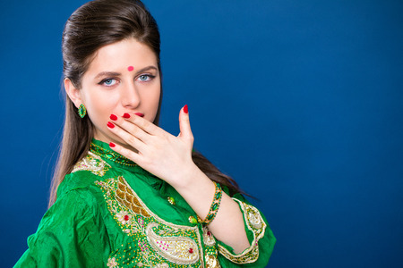 Beautiful fashion Indian woman portrait with oriental accessories earrings. Arabic girl with beauty jewels. Hindu model with perfect make-up. India Stock Photo