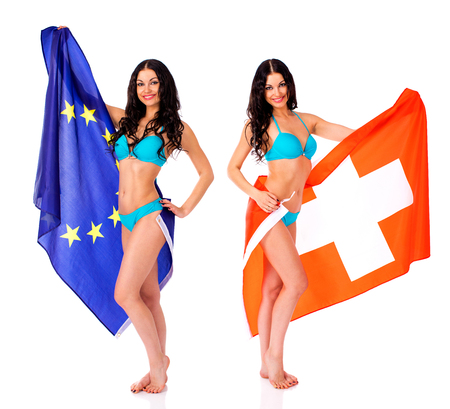 Collage Young beautiful brunette women in blue bikini holding a large flag of Switzerland and European, isolated on white background