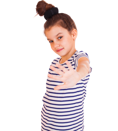 Portrait of a little girl making stop gesture using both hands, isolated over white background Stock Photo