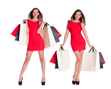 Collage. Two Fashion women portrait isolated. White background. Happy girl hold shopping bags. Red dress. female beautiful models