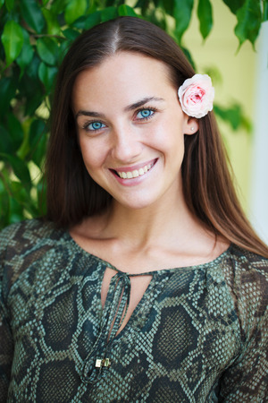 Close up portrait of beautiful young happy brunette woman with fresh and clean skin, summer street outdoors Stock Photo