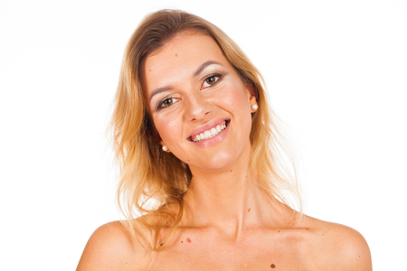 Make up style. Portrait of a young beautiful blonde woman with moles on her face - without retouching, isolated on white background