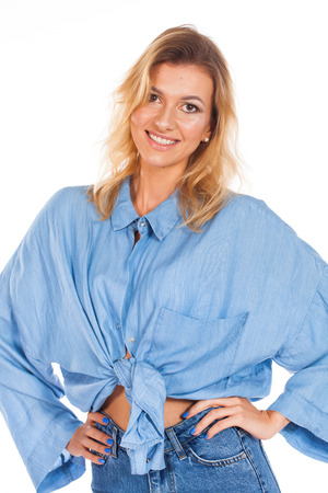 Real people without retouching. Portrait of a young beautiful blonde woman with moles on her face, isolated on white background