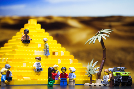 Modern Children constructor - Minifigurki little people. Group of tourists near the Egyptian pyramid