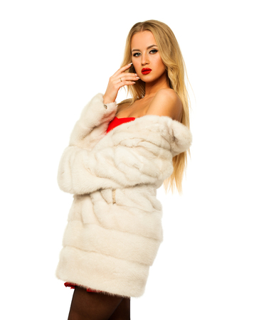 Happy Beautiful young blonde woman in white mink fur coat. Isolated on white background