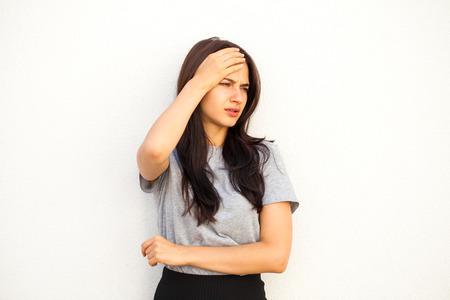 Sad brunette woman, isolated on white background