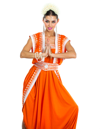 Caucasian brunette woman in orange indian national dress sari in studio on white isolated background