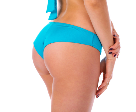 Body Part buttocks. Turquoise bikini. Close up photo of perfect female body isolated on white background Imagens