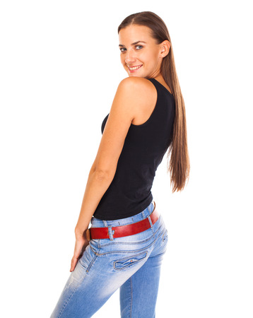 Happy brunette woman in blue jeans and black t-shirt, isolated on white background