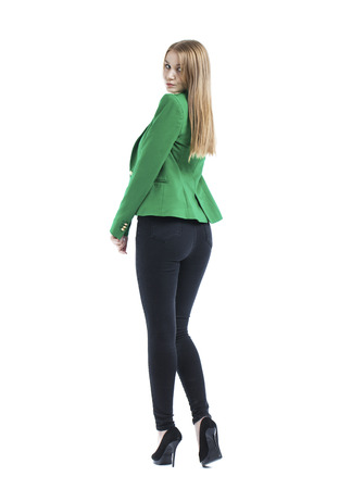 Full body, happy blonde model in jeans and green jacket, isolated on white background
