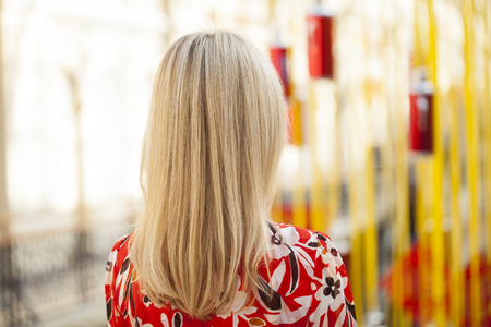 Female Long blonde hair, rear view, indoor beauty salon