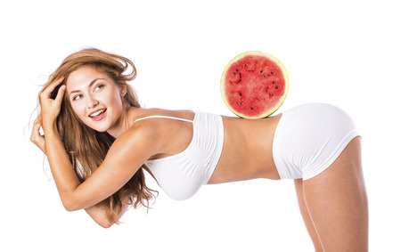 Fitness diet, Slice of watermelon. Young beautiful blonde woman in white fitness clothing, isolated on white background