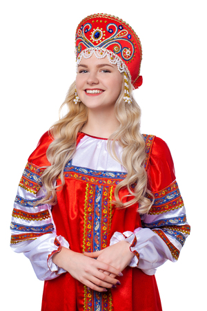 Traditional Russian folk costume, portrait of a young beautiful blonde girl in red dress, isolated on white background Stock Photo