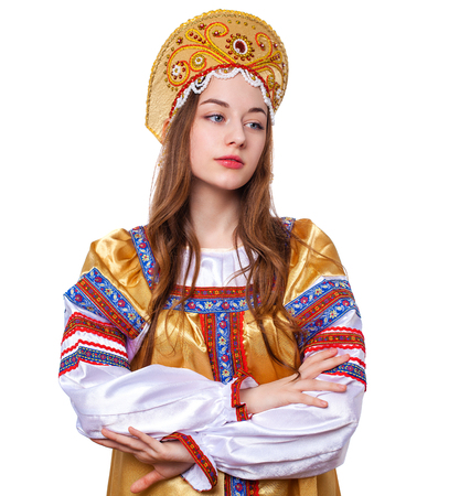 Traditional Russian folk costume, portrait of a young beautiful girl isolated on white background