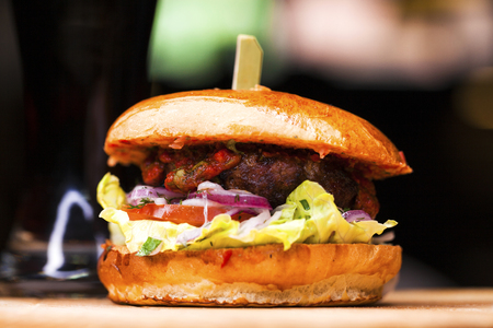 Restaurant dish - beef hamburger, dark ondoor