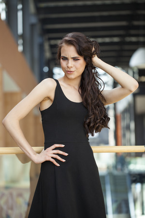 Make up beauty. Close up portrait young brunette woman in black dress, indoor Stock Photo - 124957227