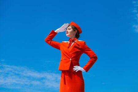 Beautiful stewardess dressed in official red uniform Archivio Fotografico