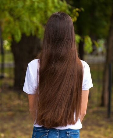 Close up Female long brunette hair, rear view, summer park outdoor