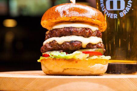 Restaurant dish - beef hamburger, dark ondoor Stock Photo