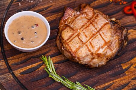 Restaurant dish pork steak on a wooden board Stock Photo