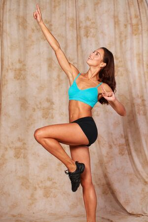 Fitness female body. Young beautiful girl in a sports uniform posing in the studio Stock Photo