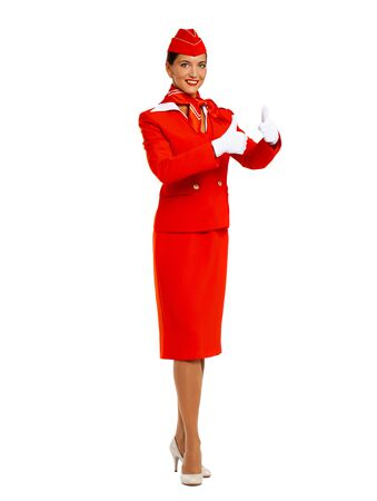 Close up portrait of a young beautiful Russian stewardess in red uniform - isolated on white background