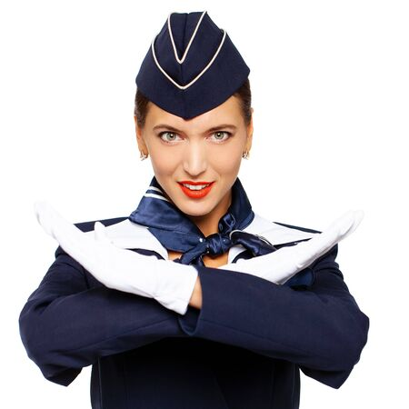 Close up portrait of a young beautiful Russian stewardess in dark blue uniform - isolated on white background Banco de Imagens